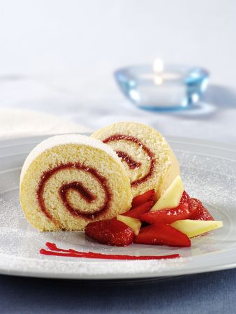 swiss roll: Two slices of Swiss roll with jam filling