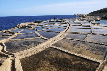 evaporation: Salt evaporation ponds off the coast of Gozo  Stock Photo