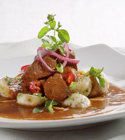 Serving of goulash with potato dumplings Stock Photo - 5271968