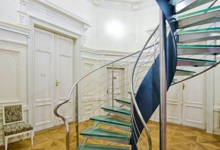 Modern spiral staircase  in historical setting - interior photo