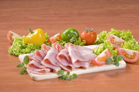 thinly: Slices of good quality bacon and fresh vegetables