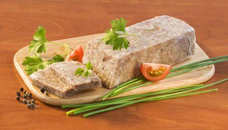 brawn: Pork brawn terrine on a wooden cutting board  Stock Photo