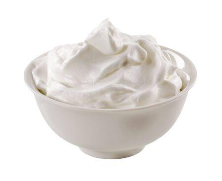 Bowl of white yoghurt isolated on white photo