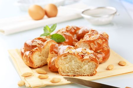 Sweet braided bread topped with almonds photo