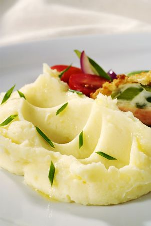 Mashed potatoes topped with fresh chopped chives   photo