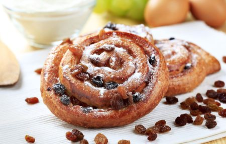 danish: Danish pastries with raisins sprinkled with icing sugar