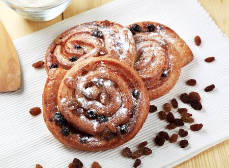 Danish pastries with raisins sprinkled with icing sugar