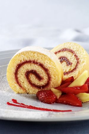 Two slices of Swiss roll with jam filling