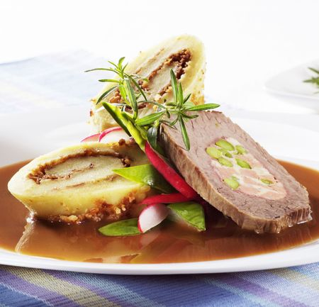 Slice of beef roll with filled potato dumplings  photo