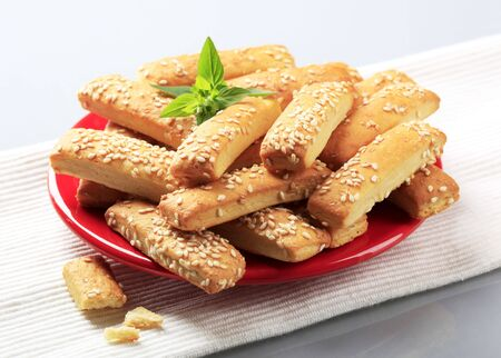 topped: Crispy snacks topped with sesame seeds - closeup