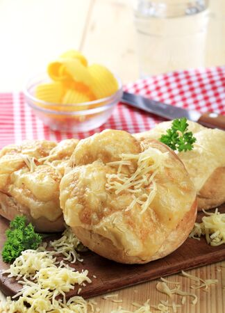 Bread buns with melted cheese on top  photo