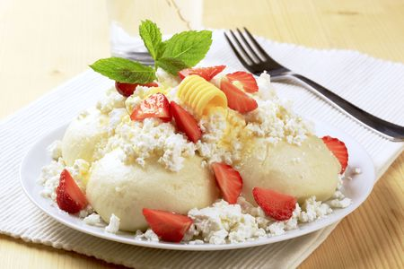 Fruit dumplings sprinkled with curd cheese - detail photo