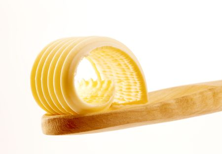 Butter curl on a wooden spoon  photo