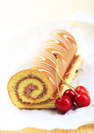 swiss roll: Swiss roll and fresh cherries Stock Photo