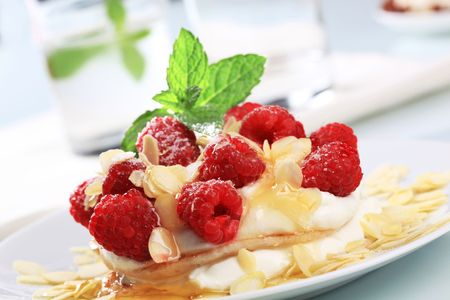 Pancakes with curd cheese, raspberries and almond flakes photo