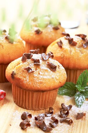 chocolate shavings: Muffins topped with chocolate shavings  Stock Photo