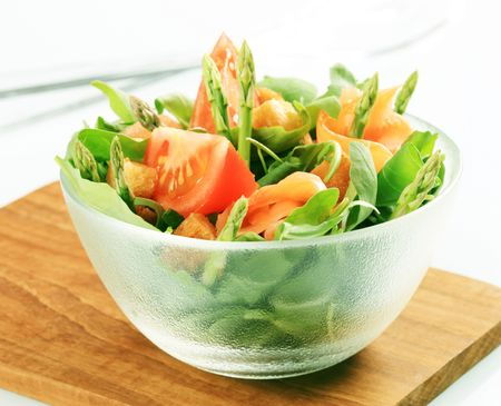 the greens: Bowl of greens with smoked salmon Stock Photo