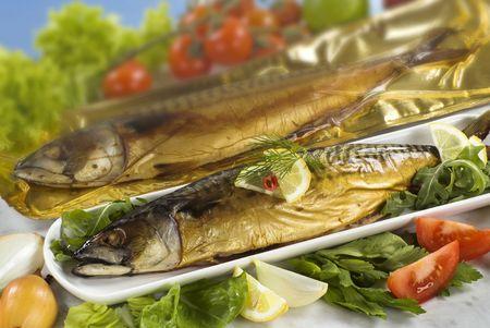 Closeup of two smoked mackerel  photo