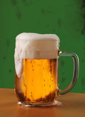 poured: Mug of Freshly Poured Beer with Overflowing Foam