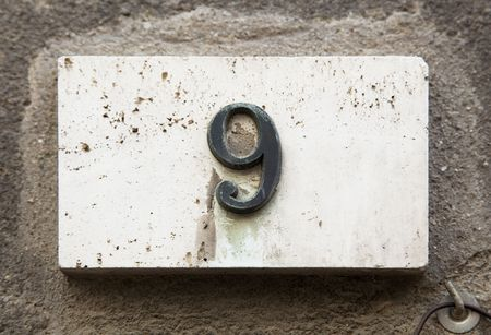 address: Block number on a weathered wall - detail Stock Photo