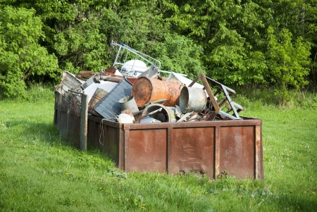 dumpster: Rusty waste container full of scrap metal  Stock Photo