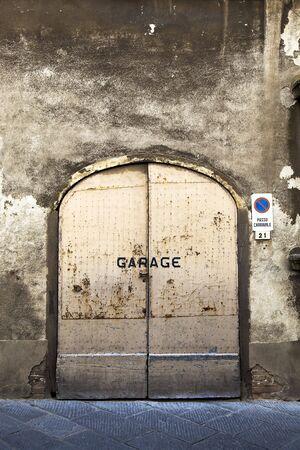 Weathered wall and rusty garage door Stock Photo - 5441686
