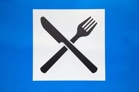 fork in the road: White and blue restaurant sign