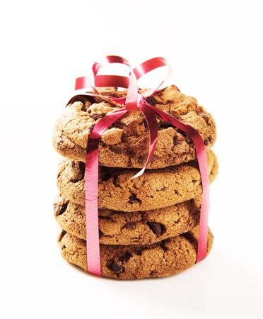Chocolate chip cookies tied with a red ribbon photo