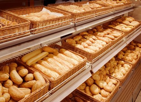 shop interior: Variety of baked products on shelves at a supermarket