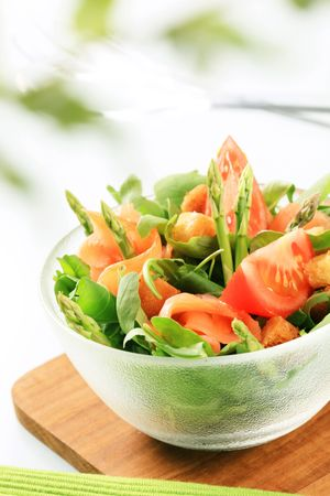 Bowl of greens with smoked salmon and asparagus  photo