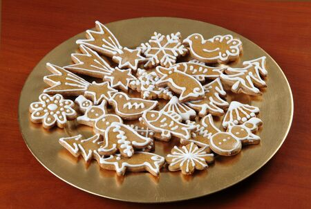 Christmas Gingerbread Cookies on a Golden Plate photo