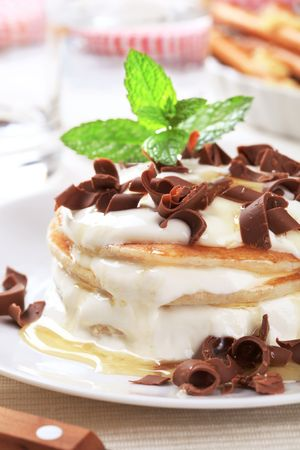 curd: Pancakes with curd cheese topped with chocolate shavings Stock Photo