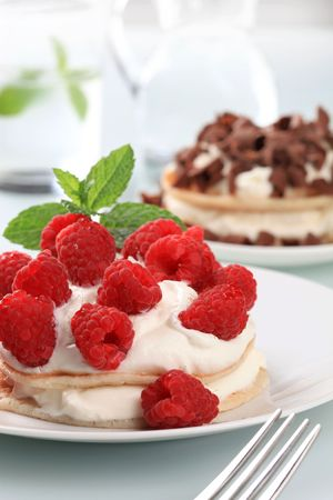 Pancakes with curd cheese and fresh raspberries photo