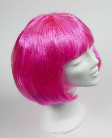 mannequin head: Pink wig on a white mannequin head  Stock Photo