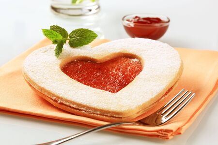 Heart shaped shortbread cookie with jam filling photo