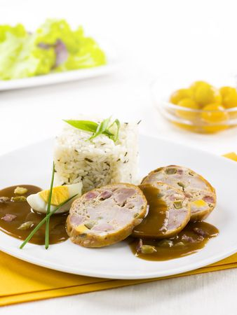 Slices of roast pork roll with rice  photo