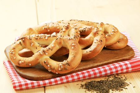 nibbles: Soft pretzels with caraway seeds on top Stock Photo
