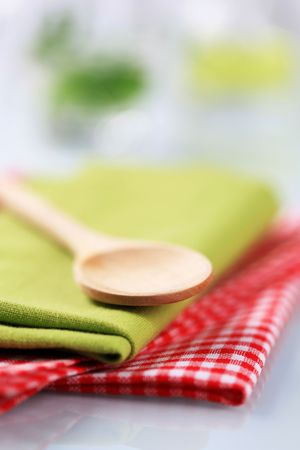 Wooden spoon and tea towels  photo