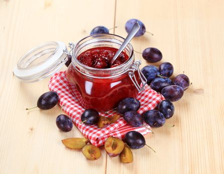 preserve: Jar of plum preserve and fresh plums