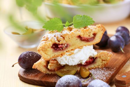 Slices of plum cake with curd cheese photo