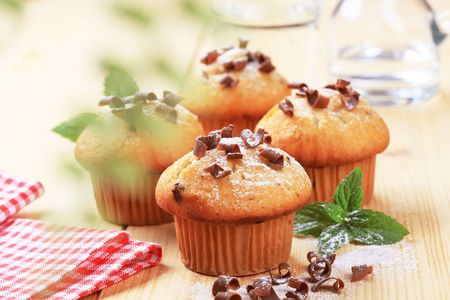 chocolate shavings: Tasty muffins topped with chocolate shavings  Stock Photo