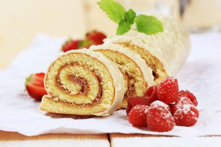 swiss roll: Swiss roll and fresh raspberries Stock Photo