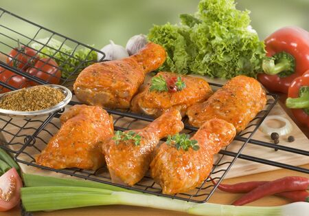 Marinated chicken drumsticks ready for a barbecue  photo