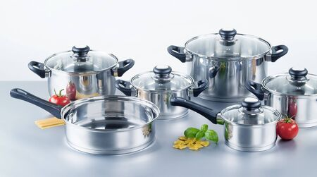 Set of stainless steel pots and pans Imagens