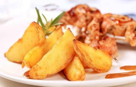 wedges: Baked potato wedges and roast meat rolls