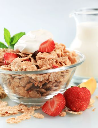cereal bowl: Bowl of breakfast cereal topped with white yogurt