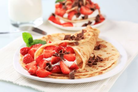 curd: Crepes with curd cheese and strawberries  Stock Photo