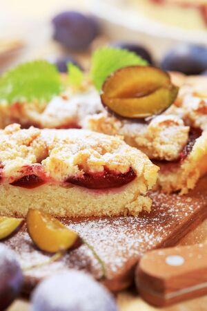Slices of freshly baked plum cake photo