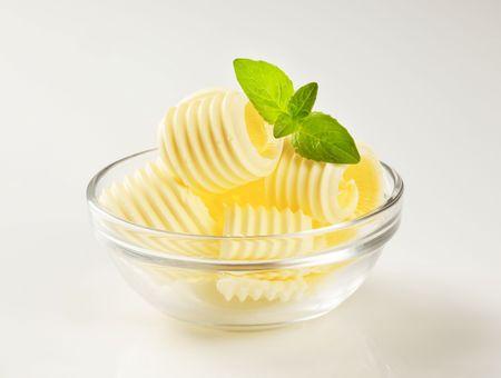 curls: Butter curls in a glass bowl