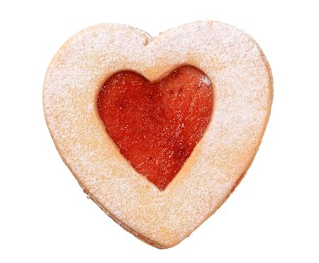Heart shaped shortbread cookie isolated on white photo